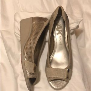 beige and gold anne Klein sports open toe shoes.